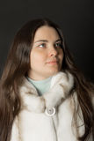 Girl in a white fur coat closeup Royalty Free Stock Image