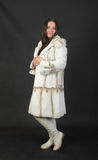Girl in a white fur coat Royalty Free Stock Photo