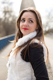 Girl in white fur coat Stock Image