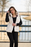 Girl in white fur coat Stock Photos