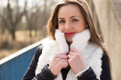 Girl in white fur coat Royalty Free Stock Image