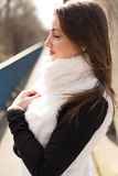 Girl in white fur coat Stock Images
