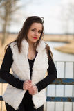Girl in white fur coat Royalty Free Stock Photo