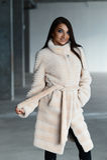 Girl in a white fur coat posing in studio. Cute girl in a white fur coat posing in studio Royalty Free Stock Photography