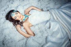 Girl on white fur. Stock Images