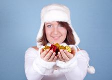 Girl in white giving a lot of presents Stock Image