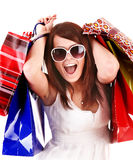 Girl in white glasses with shopping bag. Royalty Free Stock Image