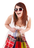 Girl in white glasses with shopping bag. Stock Photo