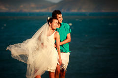 girl in white and guy stand in sunrays Royalty Free Stock Images