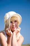 Girl in white hat Royalty Free Stock Image