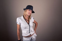 Girl in white with hat Stock Photos