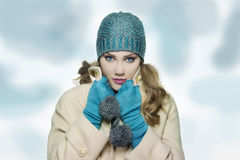 Girl with white hat and scarf in sweater winter time concelt. Beautiful girl woman in fashion winter clothes season concept royalty free stock images