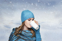 Girl with white hat and scarf in sweater winter time concelt. Beautiful girl woman in fashion winter clothes season concept drinking hot tea, coffee, chocolate stock photo