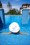 Girl, white hat and swimming pool Royalty Free Stock Photo