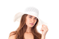 Girl in white hat with wide brim. Portrait of attractive girl in white hat with wide brim on white background royalty free stock photography