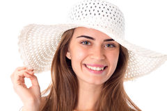 Girl in white hat with wide brim. Portrait of beautiful girl in white hat with wide brim isolated on white background stock images