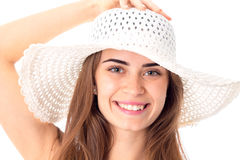 Girl in white hat with wide brim. Portrait of cheerful girl in white hat with wide brim on white background stock image