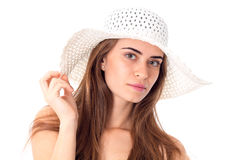 Girl in white hat with wide brim. Portrait of young beautiful girl in white hat with wide brim isolated on white background royalty free stock photography