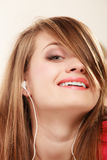 Girl with white headphones listening to music Stock Image