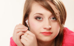 Girl with white headphones listening to music Royalty Free Stock Photography