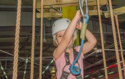 Close up, the adventure Park the kid in the white helmet Royalty Free Stock Photos
