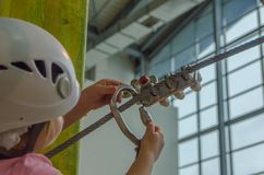 The girl in the white helmet in the adventure Park, touches the Stock Image