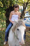 The girl and white horse. Royalty Free Stock Image