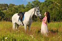 The girl with a white horse Stock Photo