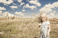 Girl with white horse Royalty Free Stock Image