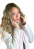 Girl in white jacket with cellular Stock Photo