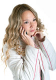 Girl in white jacket with cellular phone Stock Images
