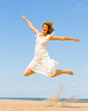Girl in white jumping Royalty Free Stock Photos
