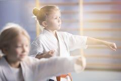 Girl in kimono practicing karate stock photos