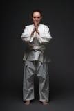 Girl in white kimono salutes Royalty Free Stock Photo