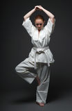 Girl in white kimono, traditional stance of aikido Royalty Free Stock Images