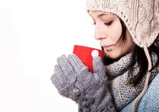 Girl in white knit cap with a red circle with pumponami hands is Stock Images