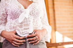 Girl with white lace crochet t-shirt sticking her hand in jeans gray pants royalty free stock photos