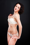 Girl in white lacy underwear on black background Stock Photo