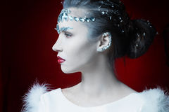 Girl with white leather adorned with rhinestones Stock Image