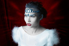 Girl with white leather adorned with rhinestones Stock Photos