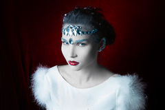 Girl with white leather adorned with rhinestones Royalty Free Stock Image