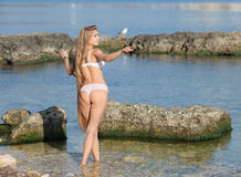 Girl in white lingerie on seashore Royalty Free Stock Photo