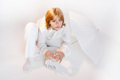 Girl in white making card house horizontal Royalty Free Stock Photo