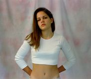 Girl in White Midriff Shirt Stock Images
