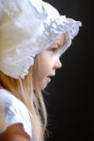 A girl in white old fashioned lace cap Royalty Free Stock Images