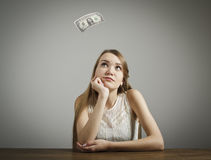Girl in white and one dollar. Royalty Free Stock Image