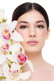 Girl with white orchid Royalty Free Stock Photography