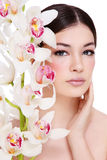 Girl with white orchid Royalty Free Stock Photos