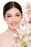 Girl with white orchid Stock Photography