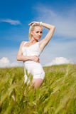 Girl in white outdoors Stock Photography
